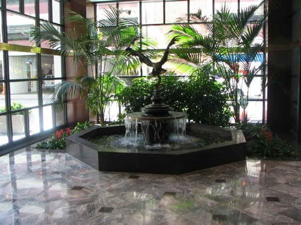 water fountain with plants and marble floor