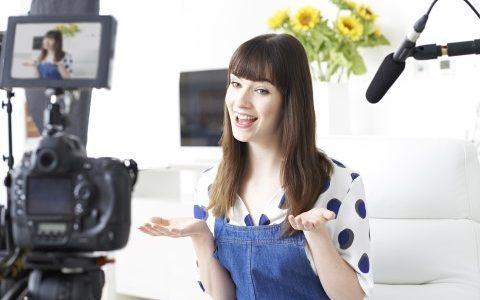 Woman recording a blog video