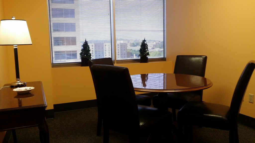 private meeting room with yellow walls and round table