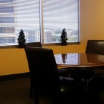meeting room with yellow walls round table and window with a view