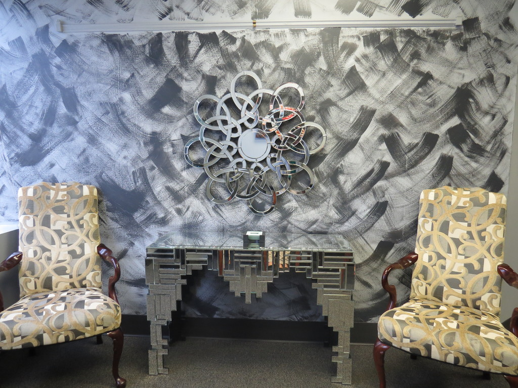 lobby with patterned chairs and mirrored table