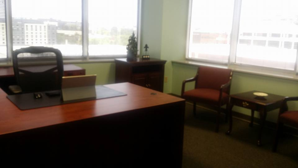private office with wooden desk with window and a view