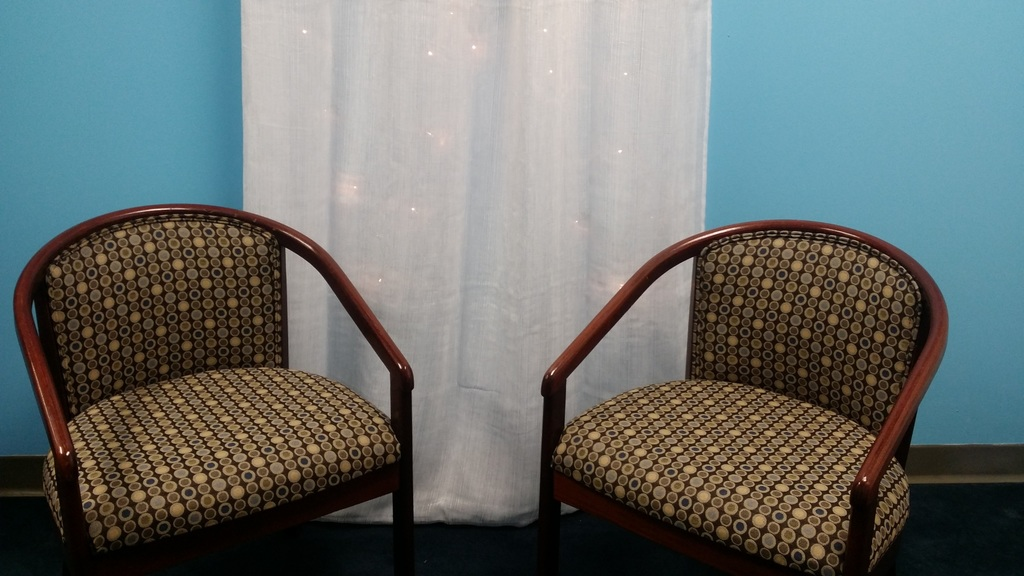 office space with blue wall and two chairs with dots