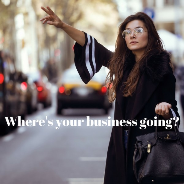 professional business woman with glasses and large bag